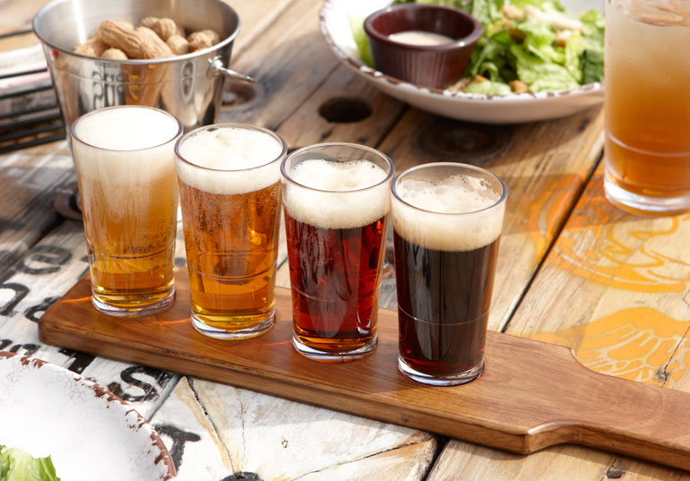 plastic-vs-glass-drinkware-wood-taster-paddle-board.jpg